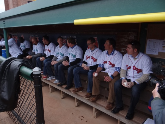 Alums patiently waiting in the dug out.